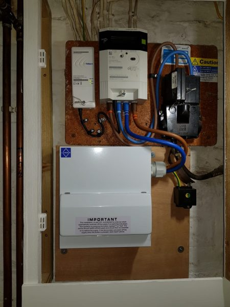 House B, Image 4. Completed installation of new fuse board with cover closed.