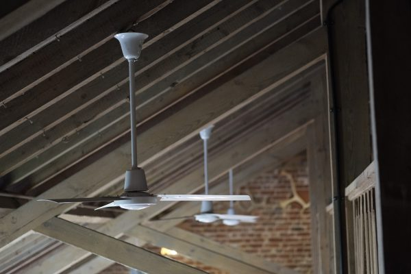 Electrical ceiling fans fixed to the roof joists at the Macknade Cafe, Faversham