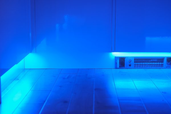Colour changing plinth lighting and integrated electric fan heater in domestic kitchen in Faversham