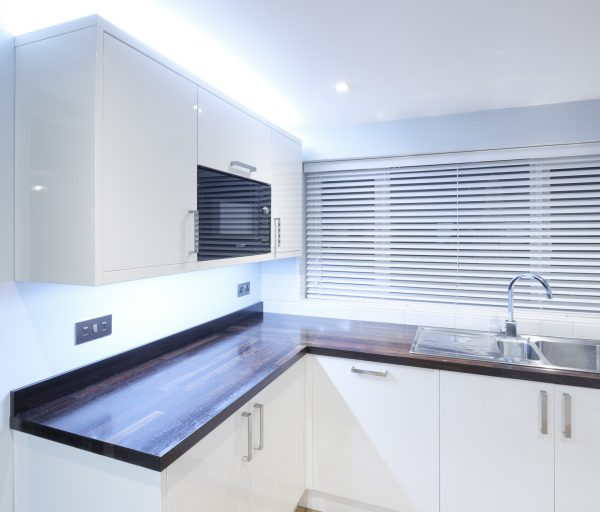 Kitchen lighting including ceiling spot lights, over unit, under cupboard and plinth lighting to create a variety of scenes in a domestic kitchen in Favresham