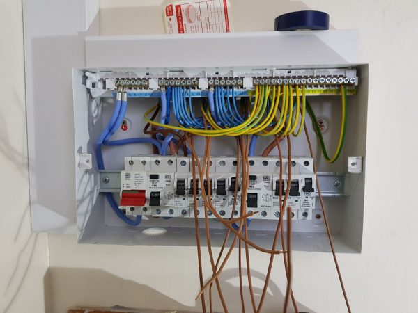 Image 1 of 2: New fuse board in position and dressed for wiring