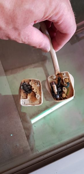 Picture shows burnt out plug caused by loose wiring