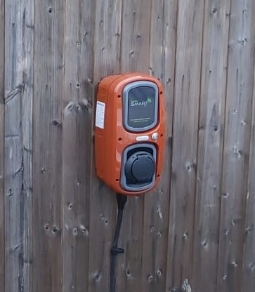 Rolect HomeSmart EV chargepoint in custom colour terracotta and grey